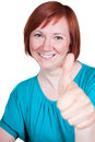 Woman is happy and thumb up middle aged smiling shows Stock Images