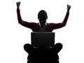 Woman happy winning computing laptop computer silhouette one caucasian in studio isolated on white background Royalty Free Stock Images