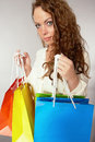 Woman has fun on spending spree Stock Photos