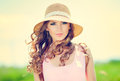 Woman in hat beautiful happy on summer meadow Royalty Free Stock Images