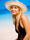 Woman in hat and bikini Stock Photos