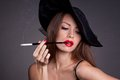 Woman in hat with cigarette beautiful elegant Stock Images