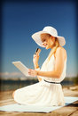 Woman in hat doing online shopping outdoors internet and lifestyle concept beautiful Royalty Free Stock Image