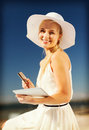 Woman in hat doing online shopping outdoors internet and lifestyle concept beautiful Stock Photography
