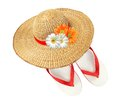 Woman hat with flowers and flip flops isolated on white Royalty Free Stock Photo