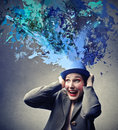 Woman with a hat holding whose coming out colours Royalty Free Stock Photography