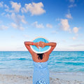 Woman in hat relaxing at Caribbean Sea Royalty Free Stock Images