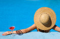 Woman hat relaxing pool cosmopolitan cocktail Stock Photography