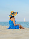 Woman with a hat on sandy beach Royalty Free Stock Photo