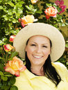 Woman in hat staying in the garden Stock Photography