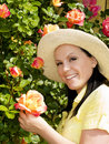 Woman in hat staying in the garden Stock Images