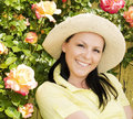 Woman in hat staying in the garden Royalty Free Stock Photos