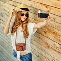 Woman in hat and sunglasses taking self portrait from vintage fi Royalty Free Stock Photo