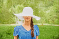 Woman in a hat with a wide brim Royalty Free Stock Photo