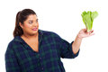 Woman hates lettuce plus size over white background Stock Images