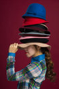 Woman and hats Stock Image
