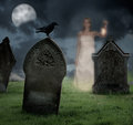Woman haunting cemetery holding lantern haunts at halloween Royalty Free Stock Photos