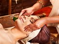 Woman having ayurveda spa treatment. Royalty Free Stock Photography