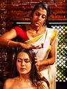 Woman having ayurveda spa treatment young women head Stock Image
