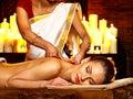 Woman having ayurvedic spa treatment pouring milk Royalty Free Stock Photos
