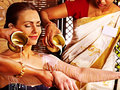 Woman having ayurvedic spa treatment pouring milk Royalty Free Stock Photography