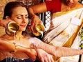 Woman having ayurvedic spa treatment pouring milk Royalty Free Stock Photography