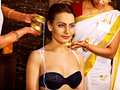 Woman having ayurvedic spa treatment pouring milk Royalty Free Stock Photo