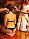 Woman having ayurvedic spa treatment young women oil ayurveda Stock Image