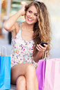 Woman having a break from shopping young with bags Stock Images