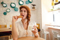 Woman having breakfast with cookies and milk at the table Royalty Free Stock Photo