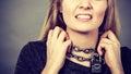 Woman having chain around neck