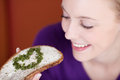 Woman having cheese spread and herbs in coffee shop closeup of happy young Stock Photo