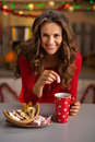 Woman having a cup of hot chocolate and Christmas sweets Royalty Free Stock Photo