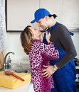 Woman having flirt with worker at kitchen Royalty Free Stock Photography
