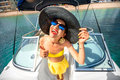 Woman having fun on the yacht young playful with big hat and sunglasses happy summer vacation top view with wide angle Stock Photo