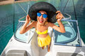Woman having fun on the yacht young playful with big hat and sunglasses happy summer vacation top view with wide angle Stock Photos