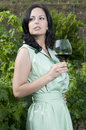 Woman having a glass of wine in a vineyard Royalty Free Stock Photography