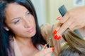 Woman having hair cut Royalty Free Stock Photo