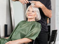 Woman having hair cut at salon senior women beauty Stock Images