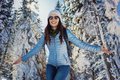 Woman having happy winter walk in snow covered woods Royalty Free Stock Photo