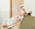 Woman having headache holding towel sad young on her head at home Royalty Free Stock Photo