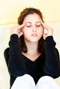 Woman having headache at home young Royalty Free Stock Photos