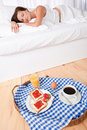 Woman having homemade breakfast lying in bed Stock Image