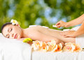 Woman having hot stone massage in spa salon adult beauty treatment concept Royalty Free Stock Images