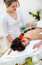 Woman having a hot stones massage Royalty Free Stock Photo