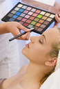 Woman Having Make Up Applied by Beautician at Spa Stock Photos