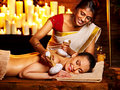 Woman having massage with pouch of rice ayurvedic Royalty Free Stock Images