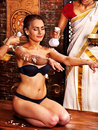 Woman having massage with pouch of rice ayurvedic Stock Photos