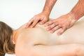 Woman having massage in spa salon