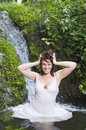 Woman having a natural spa bath in a waterfall Royalty Free Stock Images